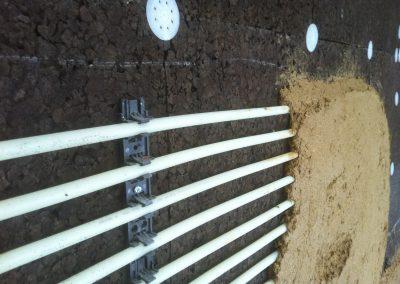 Muro radiante de tierra sobre corcho natural
